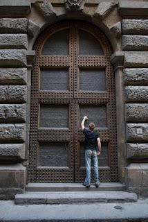 man knocking on door